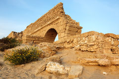 Ancient Roman aqueduct in Ceasarea. Sundown at old Ancient Roman aqueduct in Ceasarea at the coast of the Mediterranean Sea, Israel Stock Photo