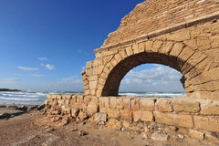 Ancient Roman aqueduct at Ceasarea. Along the coast of the Mediterranean Sea, Israel Royalty Free Stock Image