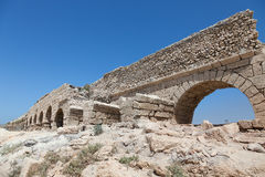 Ancient Roman aqueduct in Ceasarea Stock Photo