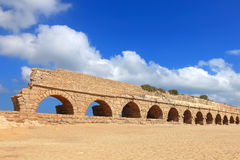 Ancient Roman aqueduct. In Ceasarea at the coast of the Mediterranean Sea, Israel Stock Photos