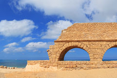 Ancient Roman aqueduct. In Ceasarea at the coast of the Mediterranean Sea, Israel Royalty Free Stock Photos