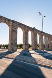 Ancient Roman aqueduct in Evora. In afternoon sun, Portugal Stock Photography