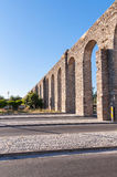 Ancient Roman aqueduct in Evora. In afternoon sun, Portugal Stock Photos