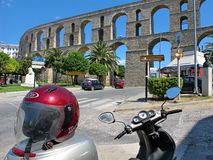 Ancient Roman aqueduct in Kavala and a scooter Stock Image