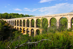 Ancient roman aqueduct in summer forest. Tarragona, Royalty Free Stock Image