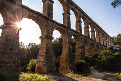 Ancient Roman aqueduct in Tarragona, Spain, sunset Royalty Free Stock Photo