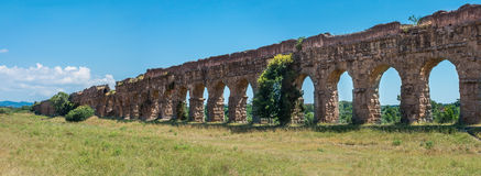 Ancient Roman Aqueducts Panorama in Rome. Crumbling roman aqueducts in park in Rome Stock Photography