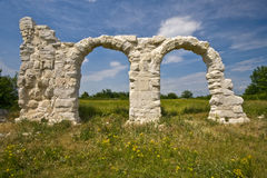Ancient Roman arches under the sun in Burnum site Royalty Free Stock Image