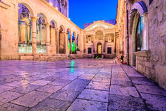 Ancient roman architecture in town Split. Colorful evening view at old city square Peristil in town Split, ancient roman architecture in front of Saint Domnius Royalty Free Stock Image
