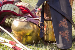 Ancient Roman armor of leather and metal lying on ground Stock Photography