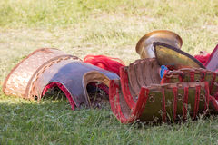 Ancient Roman armor of leather and metal lying on ground Royalty Free Stock Photo