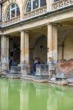 Ancient roman baths, city of Bath, England. BATH, ENGLAND - July 27, 2015: Tourists at the ancient Roman Bath Museum, West England on July 27, 2015 The Roman Royalty Free Stock Images