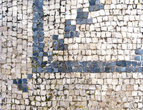 Ancient Roman blue and white mosaic floor tiles in archaeological area. A well-preserved Roman mosaic pattern is seen in the floor tiles in the area of Zippori royalty free stock photos