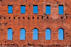 Ancient roman brick wall with blue sky. Close-up of an ancient Roman wall with brick window and blue sky Royalty Free Stock Images