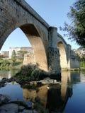 Bridge. Ancient Roman Bridge over the Miño river royalty free stock image