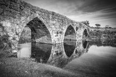 Ancient Roman bridge over Ponsul river in Idanha-a-velha Royalty Free Stock Photos