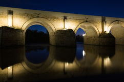Ancient roman bridge. Over  river in night Stock Photos