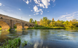 Ancient Roman bridge over Tormes river in Salamanca, Spain Stock Images