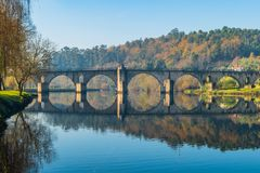 Ancient roman bridge of Ponte da Barca, ancient portuguese village in the north of Portugal.  stock photography