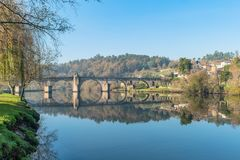 Ancient roman bridge of Ponte da Barca, ancient portuguese village in the north of Portugal.  royalty free stock photography