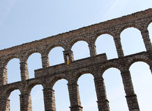 Ancient roman bridge of segovia, backlight Stock Images