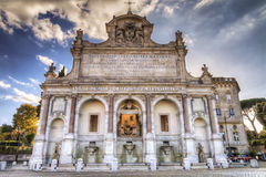 Ancient roman church and fountain Royalty Free Stock Images