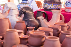 Ancient Roman clay figurines and utensils Royalty Free Stock Images
