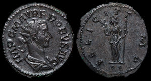 Ancient roman coin. Ancient Roman Imperial Coin. Struck in 281AD it has a picture of the ruler Probus on the obverse and the roman god Sol on the reverse Stock Photography