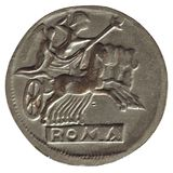 Ancient roman coin isolated over white. Ancient roman coin with chariot and horses isolated over white background Stock Images