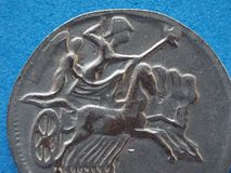 Ancient roman coin with horses and biga (chariot. Close macro detail of ancient roman coin with horses and biga (chariot royalty free stock photos