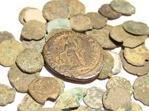 Ancient Roman Coins. Culls scattered among a white background Royalty Free Stock Photos