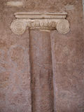 Ancient Roman Column build into wall,  Rome, Italy. Top of ancient Roman Column build into red wall,  Rome, Italy Stock Image