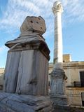 This is the ancient Roman column that marks the end of the Appian Way. It is located in the city of Brindisi, in Puglia, Italy. Ancient roman column marks end stock photo