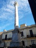 This is the ancient Roman column that marks the end of the Appian Way. It is located in the city of Brindisi, in Puglia, Italy. Ancient roman column marks end royalty free stock photo