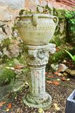 Ancient Roman column and stone vessel. Carved stone work Stock Photo