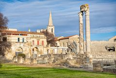 Ancient roman columns and amphitheatre in Arles Stock Photo
