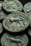 Ancient roman copper coins in green patina stock photo