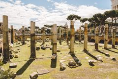 ancient roman forum ruins on sunny day,