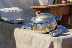 Ancient Roman helmet and ax on table Royalty Free Stock Photo