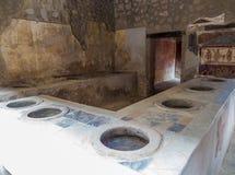 Ancient Roman kitchen in Pompeii Royalty Free Stock Photos