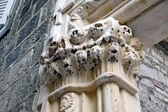 Ancient Roman Marble Pillar, Diocletian`s Palace, Split, Croatia. Detail of Ancient Roman architecture, with a marble pillar with small lion heads on capital stock photos