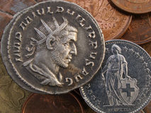Ancient Roman & modern Swiss coin Stock Photo