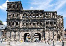 Ancient roman monument. TRIER, GERMANY - JUNE 28, 2010: view of tourists near ancient roman monument `Porta Nigra` Black Gate in Trier city. The Porta Nigra was Stock Images