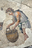 Ancient roman mosaic. Of a man carrying a basket from the remains of the Great Palace at Constantinople Stock Image