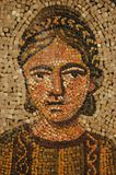 Ancient roman mosaic of young woman. Roman mosaic of a young woman in the patriarchal basilica of Aquilea.  This close-up  is a segment of an immense mosaic Stock Images