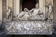 Ancient Roman river god's statue in the Vatican Museum Stock Images