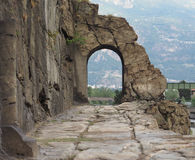 Ancient roman road arch in Donnas Stock Photography