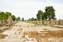 Ancient Roman road. Ancient Roman stone road connecting Ephesus with its port, Ephesus, Turkey Royalty Free Stock Photo