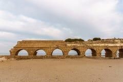 Ancient Roman ruins of aqueduct in Ceasarea Israel historical monument. Ancient Roman ruins of aqueduct in Ceasarea Israel historical monument royalty free stock photos