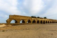 Ancient Roman ruins of aqueduct in Ceasarea Israel historical monument. Ancient Roman ruins of aqueduct in Ceasarea Israel historical monument royalty free stock images